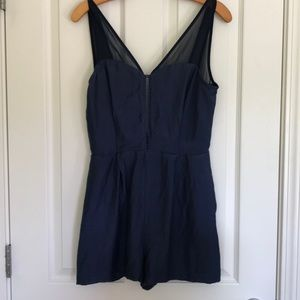 BCBGeneration blue romper with open back. NWT